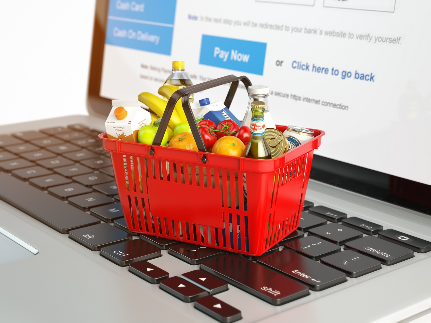 shopping-basket-with-variety-of-grocery-products-ion-laptop-keyb