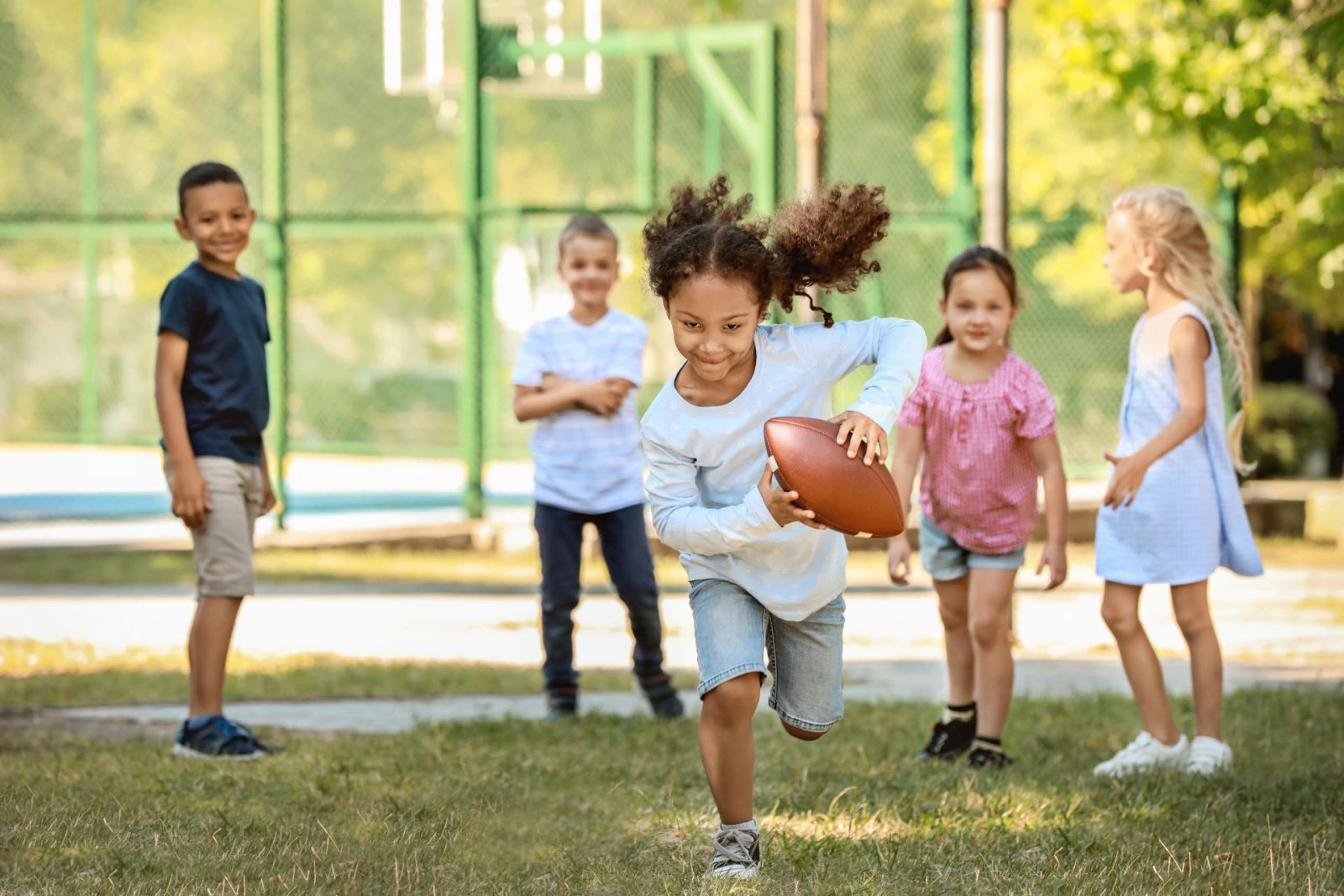 girl-running-with-football