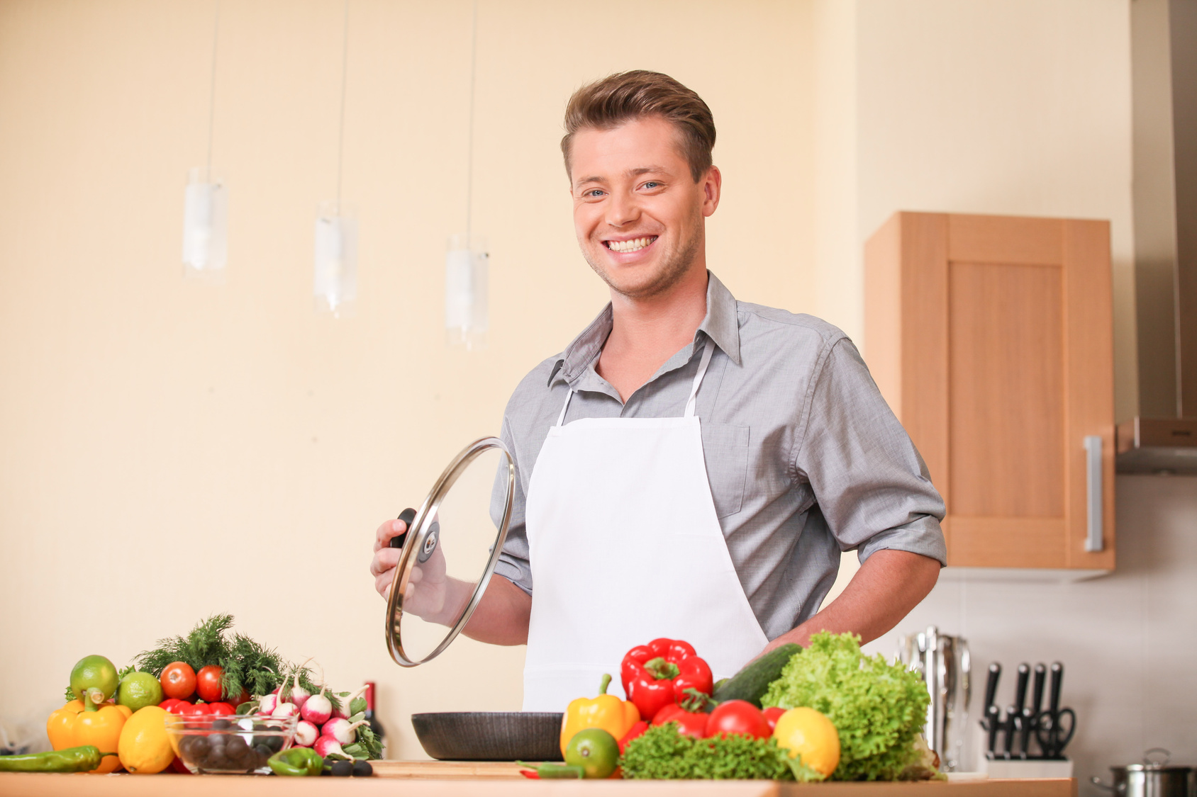 waist-up-of-man-holding-frying-pan-lid