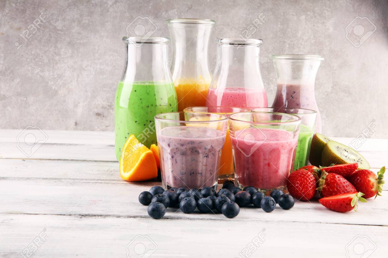 assortment-of-fruit-smoothies-in-glass-bottles-fresh-organic-smoothie-ingredients